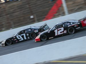 Derek Griffith (12g) chases Joey Polewarczyk Jr. Saturday at Hickory Motor Speedway. (Adam Fenwick Photo)