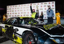 Eric Nascimento Jr. celebrates after a victory Saturday at Madera Speedway. (Jason Wedehase Photo)
