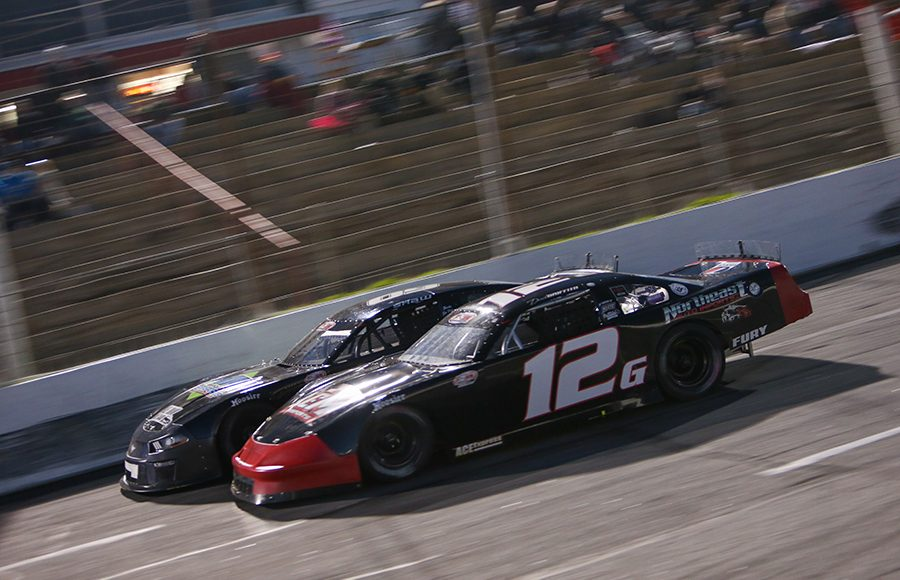 Derek Griffith (12g) battles D.J. Shaw during Friday's Easter Bunny 150 make-up race at Hickory Motor Speedway. (Adam Fenwick Photo)