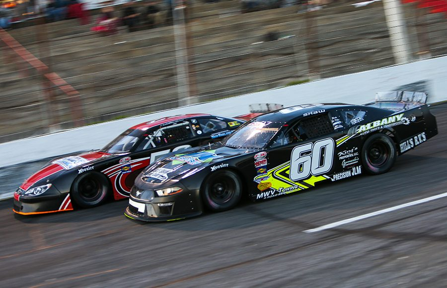 D.J. Shaw (60) races alongside Jake Matheson Friday at Hickory Motor Speedway. (Adam Fenwick Photo)