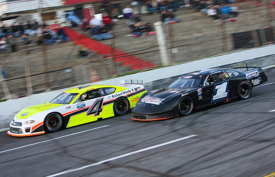 Ben Rowe (4) battles Charlie Sanborn Friday at Hickory Motor Speedway. (Adam Fenwick Photo)
