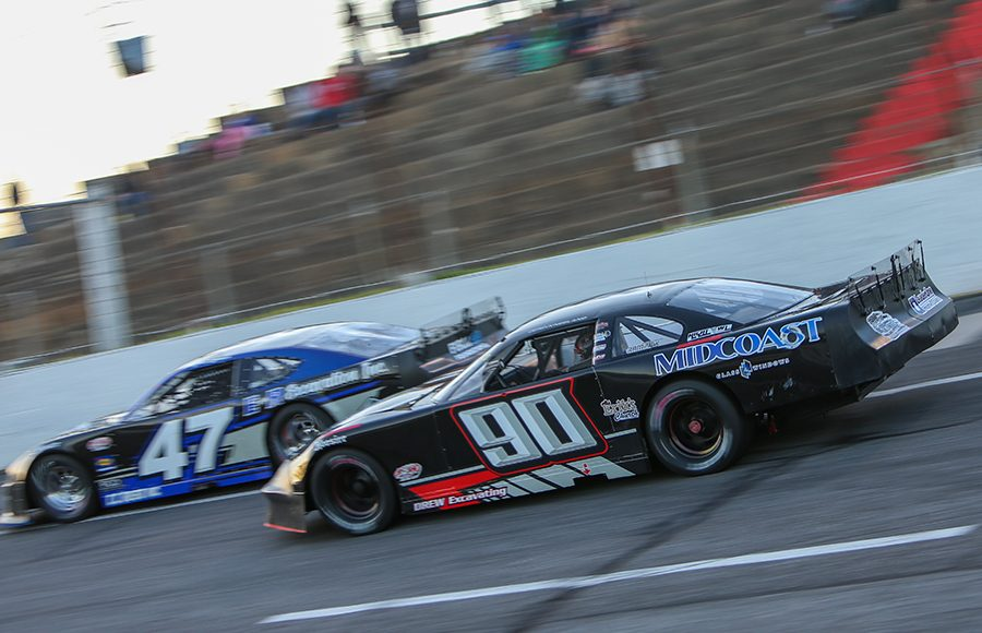 Derek Kneeland (90) chases Gabe Brown during Friday's Easter Bunny 150 make-up race at Hickory Motor Speedway. (Adam Fenwick Photo)