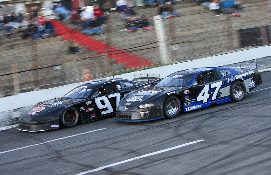 Gabe Brown (47) races alongside Joey Polewarczyk Jr. Friday at Hickory Motor Speedway. (Adam Fenwick Photo)