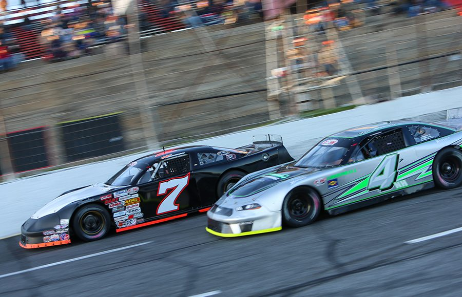 Tyler Church (7) races ahead of Trevor Bleau during Friday's Easter Bunny 150 make-up race at Hickory Motor Speedway. (Adam Fenwick Photo)