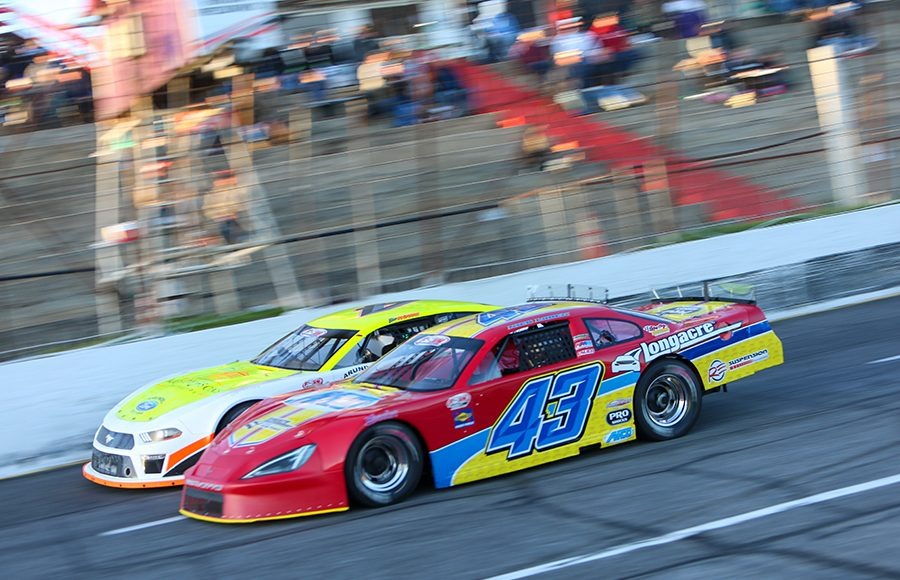 Nick Loden (43) works alongside Ben Rowe during Friday's Easter Bunny 150 make-up race at Hickory Motor Speedway. (Adam Fenwick Photo)