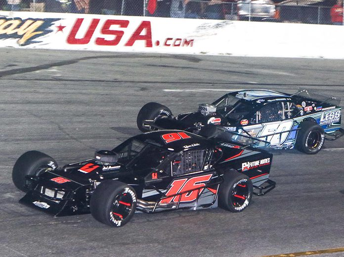 Ron Silk (16) in action earlier this year at New Smyrna Speedway. (Dick Ayers Photo)