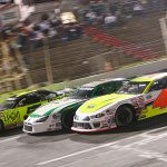 Ben Rowe (4), Stephen Donahue (31) and Tom Carey III battle three-wide during Friday's American-Canadian Tour event at Hickory Motor Speedway. (Adam Fenwick Photo)