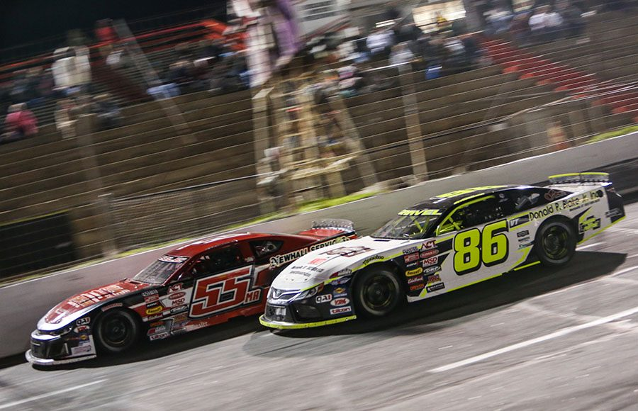 Marcel Gravel (86) battles alongside Randy Cole Jr. during Friday's American-Canadian Tour event at Hickory Motor Speedway. (Adam Fenwick Photo)