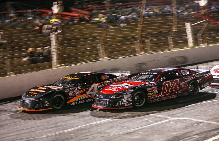 Shawn Swallow (04) and Jamie Swallow Jr. battle for position during Friday's American-Canadian Tour event at Hickory Motor Speedway. (Adam Fenwick Photo)