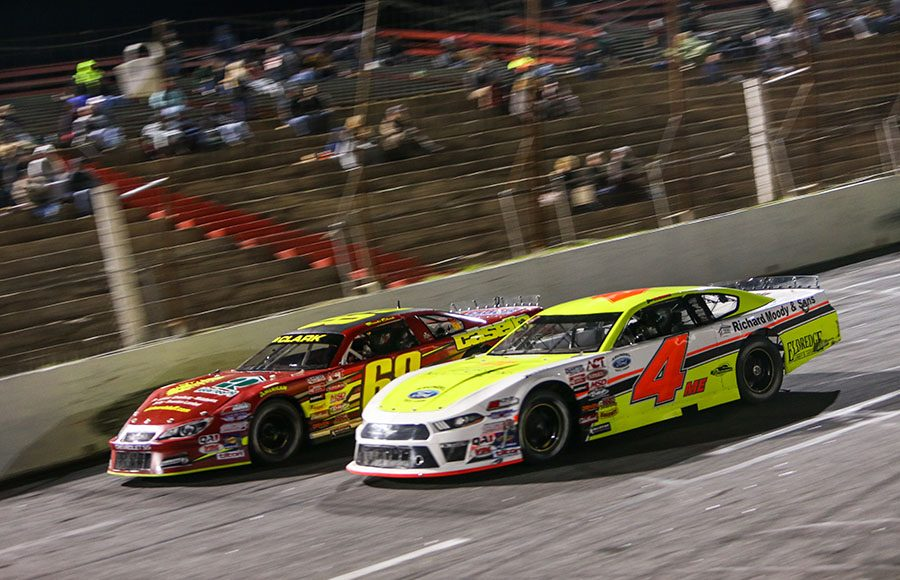 Ben Rowe (4) races under Brooks Clark during Friday's American-Canadian Tour event at Hickory Motor Speedway. (Adam Fenwick Photo)