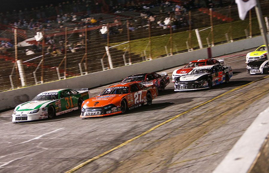 Wayne Helliwell Jr. (27) and Stephen Donahue lead the American-Canadian Tour field to the green flag Friday at Hickory Motor Speedway. (Adam Fenwick Photo)