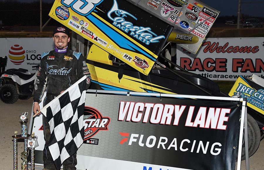 Justin Peck poses in victory lane after winning Saturday's All Star Circuit of Champions feature at Attica Raceway Park. (Frank Smith Photo)