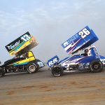 Justin Peck (13) races ahead of Cory Eliason during Saturday's All Star Circuit of Champions event at Attica Raceway Park. (Julia Johnson Photo)