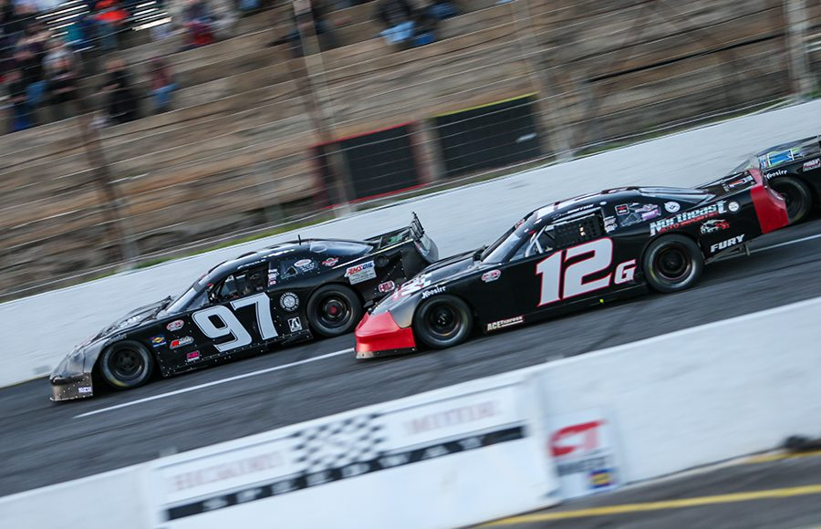 Joey Polewarczyk Jr. (97) battles Derek Griffith for the race lead Saturday at Hickory Motor Speedway. (Adam Fenwick Photo)