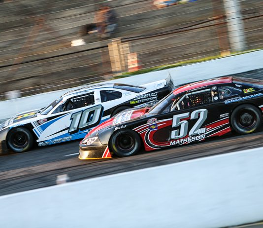 Jake Matheson (52) races under Kate Re Saturday at Hickory Motor Speedway. (Adam Fenwick Photo)