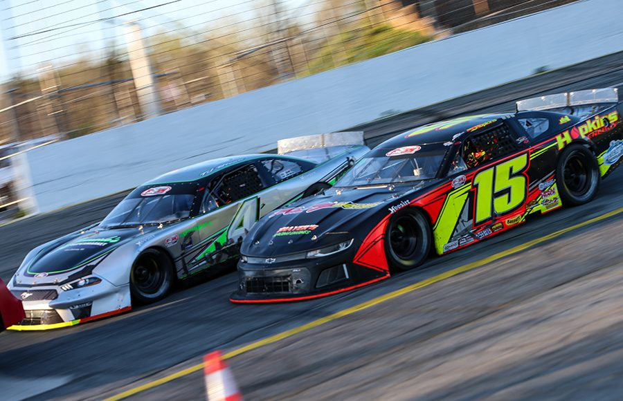 Mike Hopkins (15) battles Trevor Bleau during Saturday's Easter Bunny 150 at Hickory Motor Speedway. (Adam Fenwick Photo)