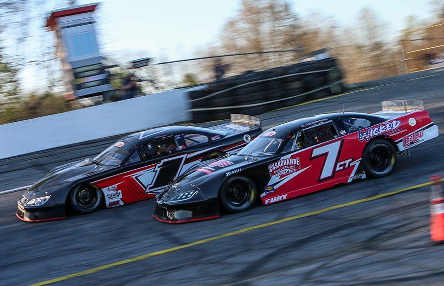 Cory Casagrande (7) races alongside Kyle DeSouza during Saturday's Easter Bunny 150 at Hickory Motor Speedway. (Adam Fenwick Photo)