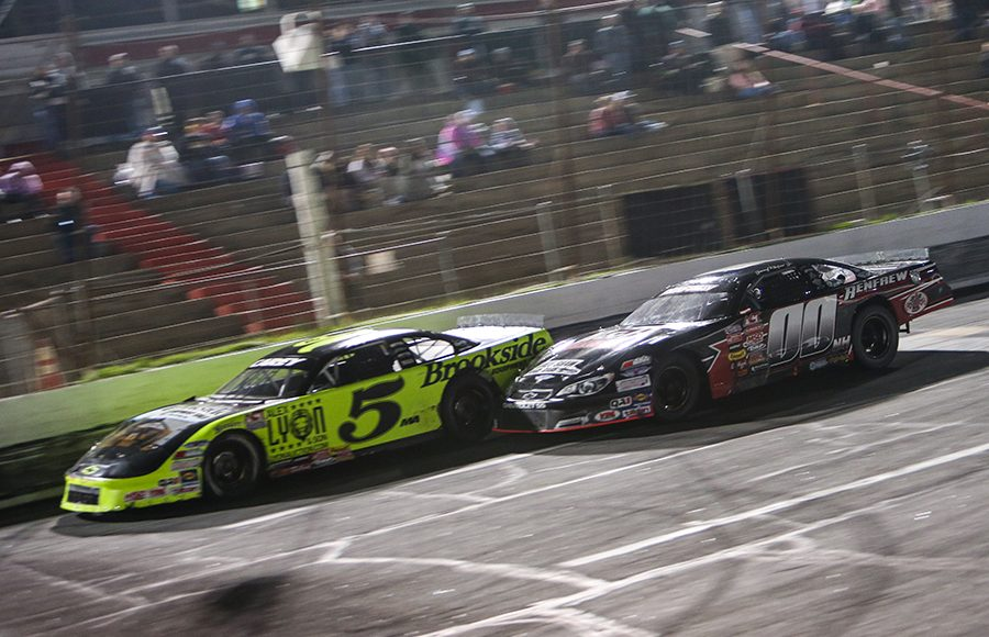 Tom Carey III (5) and Jimmy Renfrew Jr. make contact as they battle during Saturday's American-Canadian Tour race at Hickory Motor Speedway. (Adam Fenwick Photo)