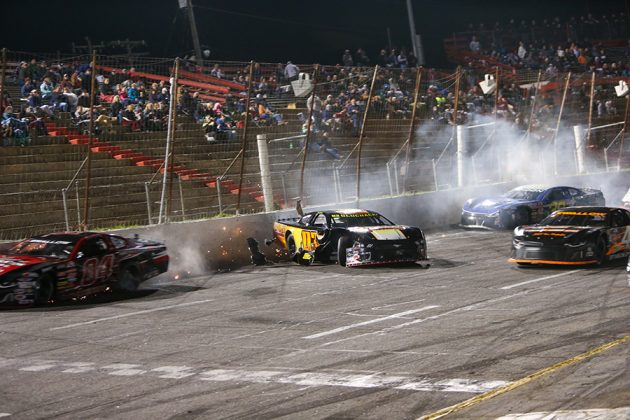 Derek Gluchacki (03) was one of several drivers involved in a multi-car crash on the front stretch during Saturday's American-Canadian Tour event at Hickory Motor Speedway. (Adam Fenwick Photo)