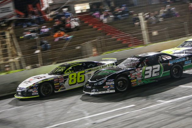 Marcel Gravel (86) battles Jeff Marshall during Saturday's American-Canadian Tour race at Hickory Motor Speedway. (Adam Fenwick Photo)