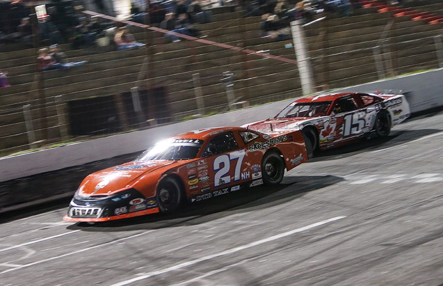 Wayne Helliwell Jr. (27) leads Mike Hopkins during Saturday's American-Canadian Tour race at Hickory Motor Speedway. (Adam Fenwick Photo)