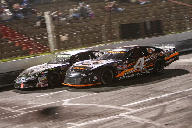 Jamie Swallow Jr. (4) races alongside Mike Kenison during Saturday's American-Canadian Tour race at Hickory Motor Speedway. (Adam Fenwick Photo)