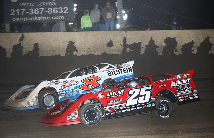 Shane Clanton (25) races under Kyle Strickler during Saturday's Illini 100 at Farmer City Raceway. (Brendon Bauman Photo)
