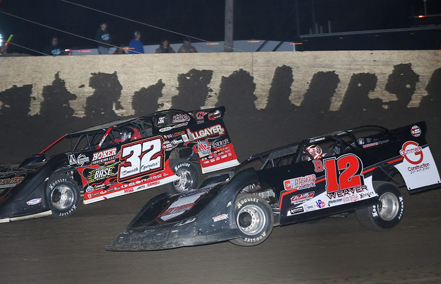 Kevin Weaver (B12) chases Bobby Pierce during Saturday's Illini 100 at Farmer City Raceway. (Brendon Bauman Photo)