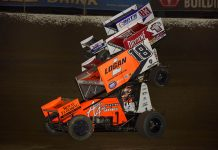 Gio Scelzi (18), Logan Schuchart (1s) and Aaron Reutzel battle three-wide during Saturday's World of Outlaws NOS Energy Drink Sprint Car Series event at Federated Auto Parts Raceway at I-55. (Mark Funderburk Photo)