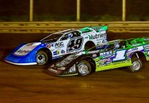 Jonathan Davenport (49) battles Tyler Erb Thursday at West Virginia Motor Speedway. (Tyler Carr Photo)
