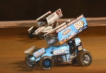 Kyle Larson (57) races around Lance Dewease at Williams Grove Speedway. (Paul Arch photo)