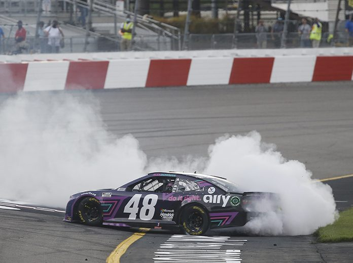Alex Bowman celebrates with a burnout after winning the Toyota Owners 400. (HHP/Chris Owens Photo)