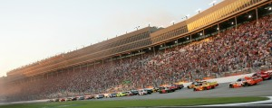 TO THE FLAG: A large crowd looks on as the field for Sunday night's NASCAR Sprint Cup Series race takes the green flag at Atlanta Motor Speedway. (HHP Photo/Alan Marler)