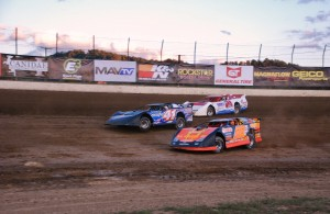 HEAD TO HEAD: Eddie Carrier, Jr. (28) and Josh McGuire (41) lead a charge during B-main action ahead of Saturday night's Lucas Oil Late Model Dirt Series event at Portsmouth (Ohio) Raceway Park. [Justin Leedy Photo]