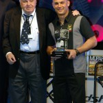 Chris Economaki presents 2008 NHRA Top Fuel champion Tony Schumacher with the Economaki Champion of Champions Award in December 2008.