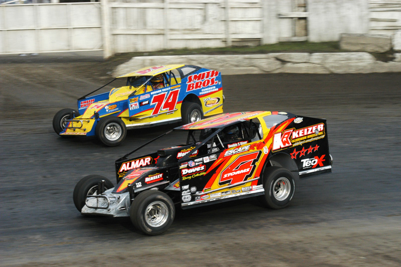 HEAD TO HEAD: Tim McCreadie (4) battles Tim Fuller en route to victory in Sunday's Eastern States 200 at Orange County Fair Speedway. (Bruce A. Bennett Photo)