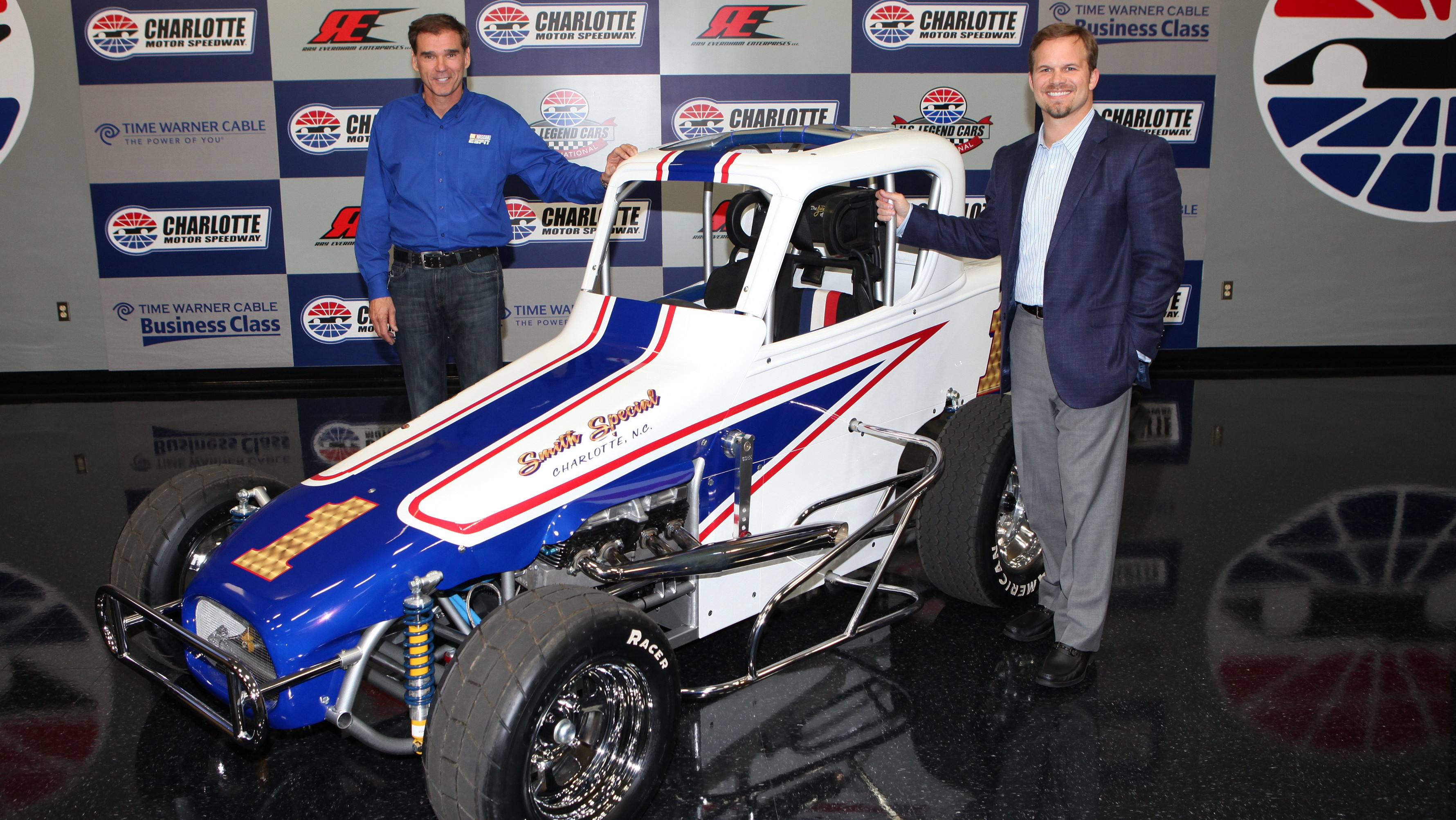 HERE IT IS: Ray Evernham (left) and Charlotte Motor Speedway President Marcus Smith unveil the U.S. Legends Modified Dirt Car Thursday. (HHP/Erik Perel Photo)