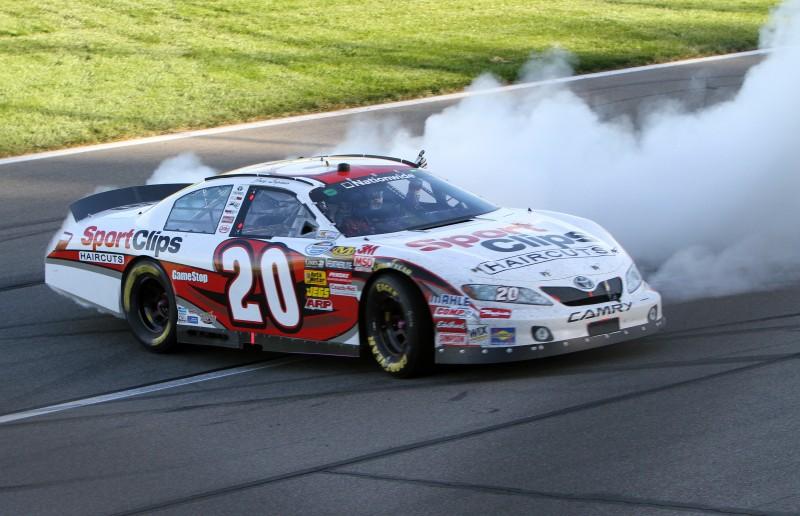 Joey Logano celebrates his win in Saturday's NASCAR Nationwide Series Kansas Lottery 300 at Kansas Speedway. (HHP/Erik Perel Photo)