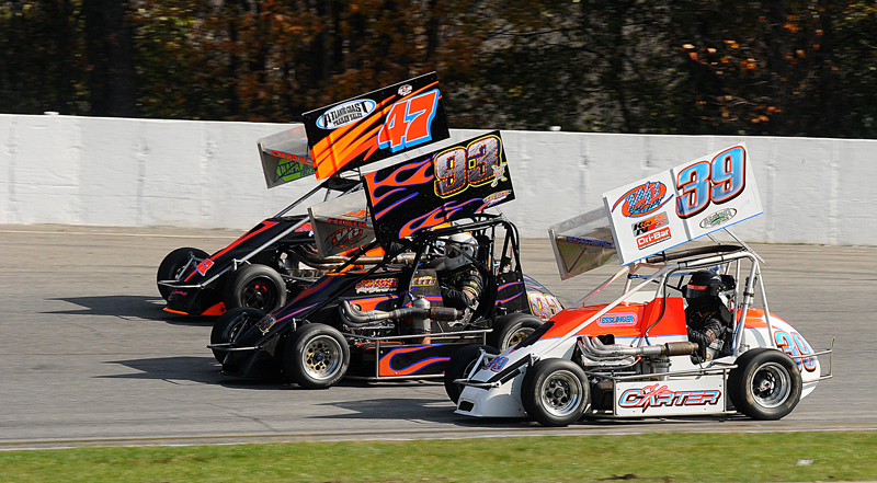 THREE AMIGOS: Randy Cabral (47), Mike Horn (93) and Cole Carter race three wide around Thompson (Conn.) Int'l Speedway during Sunday's Northeastern Midget Ass'n season finale. (John DaDalt Photo)