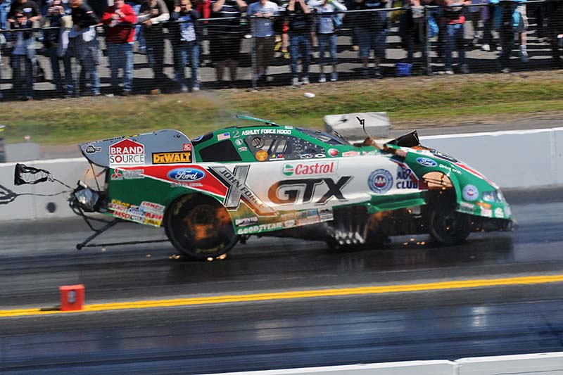KABOOM!: The engine on Ashley Force Hood's NHRA Funny Car explodes, destroying the body on her Castrol GTX Ford Mustang during her a first-round meeting with Cruz Pedregon at Pennsylvania's Maple Grove Raceway Sunday. (Harry Cella Photo)