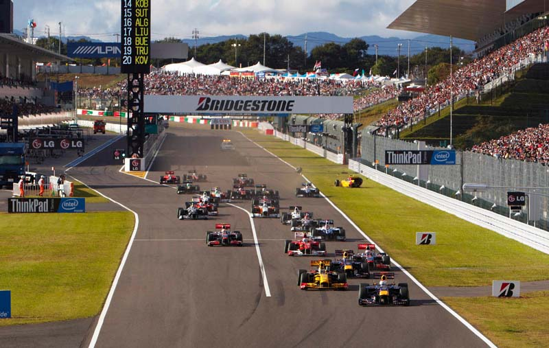 The Formula One field heads toward the first turn of the Suzuka Circuit at the start of the 2010 Japanese Grand Prix. (Steve Etherington Photo)