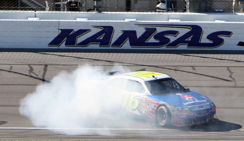 Greg Biffle celebrates his win in Sunday's NASCAR Sprint Cup Series Price Chopper 400 at Kansas Speedway. (HHP/Alan Marler Photo)