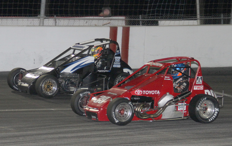GOING FOR IT: Bryan Clauson (39) races Levi Roberts for position during Thursday's Turkey Night Grand Prix at Toyota Speedway @ Irwindale, Calif.