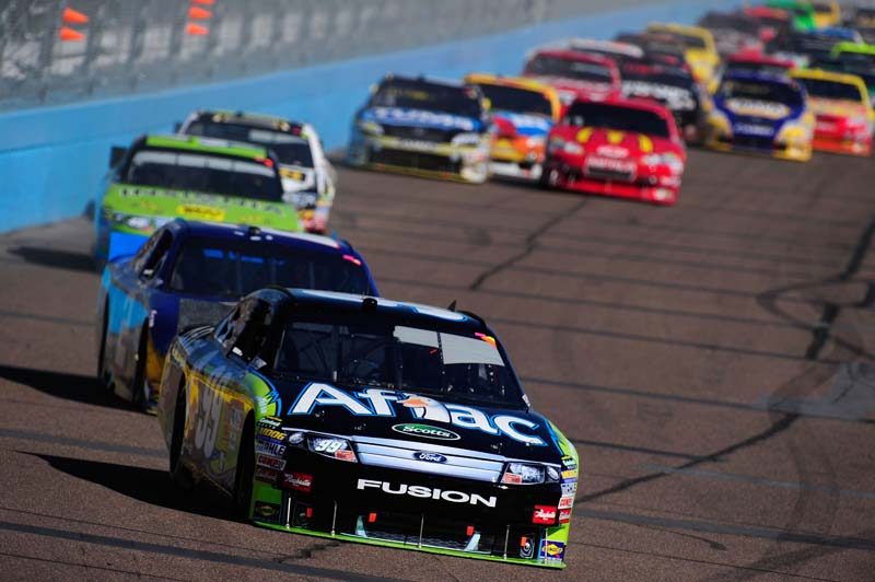 DUCK AND RUN: Carl Edwards (99) leads Sunday's NASCAR Sprint Cup Series Kobalt Tools 500 at Phoenix Int'l Raceway in Avondale, Ariz. (Robert Laberge/Getty Images Photo)