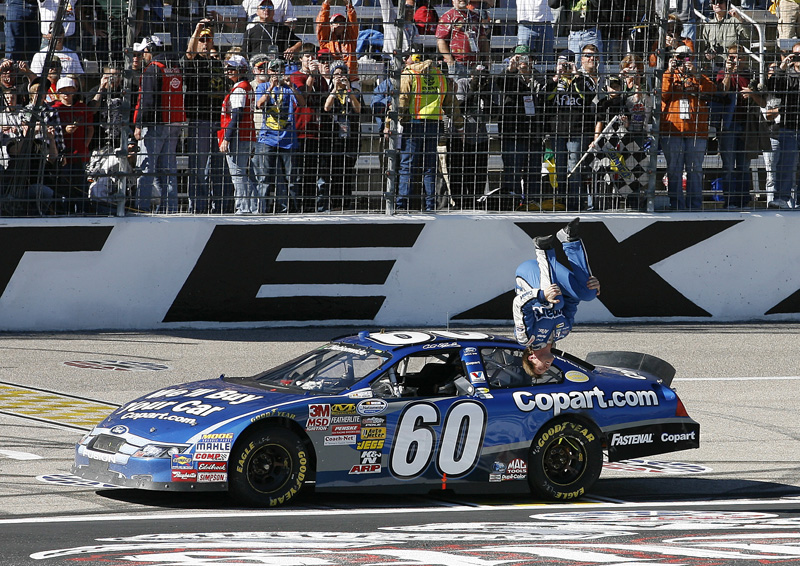 FLIPPING OUT: Carl Edwards celebrates his win in Saturday's NASCAR Nationwide Series O'Reilly Auto Parts Challenge. (HHP/Harold Hinson Photo)