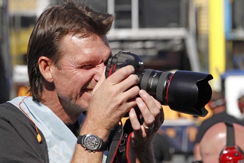 SAY CHEESE: Major League Baseball pitching legend Randy Johnson spends some time behind a camera during the NASCAR weekend at Phoenix Int'l Raceway. (HHP/Gregg Ellman Photo)