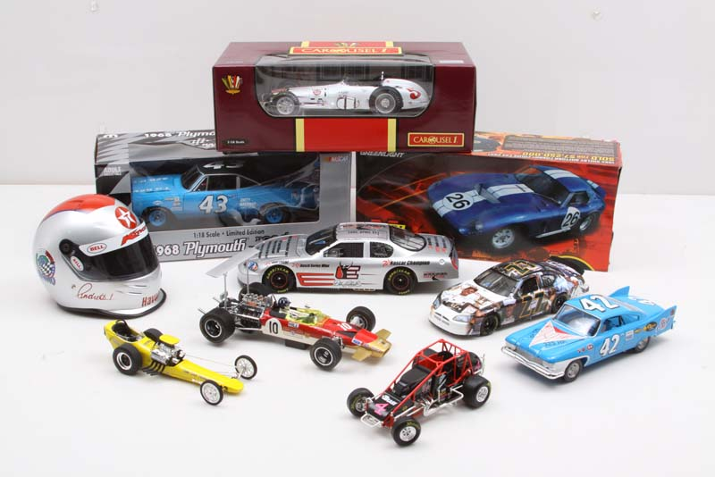 This incredible 10-piece collection includes diecast race cars and memorabilia for a few of the most famous names in all of motorsports! A $795.00 value!