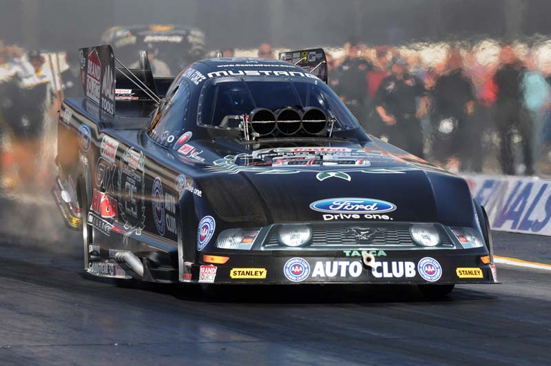 OLD DOG, NEW TRICKS: With a second-round win coupled with title rival Matt Hagan's first-round loss, John Force clinched his 15th NHRA Funny Car world championship Sunday at Auto Club Raceway at Pomona, Calif. (Angela Barazza Photo)