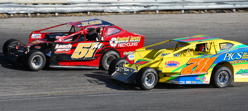 """Dominic Buffalino (51m) races with open-wheel stand out """"Liquid"""" Lou Cicconi, Jr. during the feature for dirt-style modifieds, part of the annual Turkey Derby, at New Jersey's Wall Stadium Saturday."""