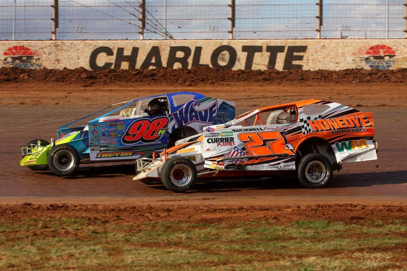 DOG FIGHT: Jimmy Phelps (98h) races to the high side of Danny Johnson during the Super DIRTcar Series 30-lap feature Saturday afternoon at The Dirt Track at Charlotte Motor Speedway. (Dick Ayers Photo)